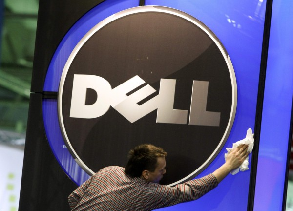 A man wipes the logo of the Dell IT firm at the CeBIT exhibition centre in Hannover in this February 28, 2010 file photo. Shares of Dell Inc soared 13 percent to a near eight-month high on Monday after Bloomberg reported the world's No. 3 PC maker is in talks with a least two private equity firms about going private.