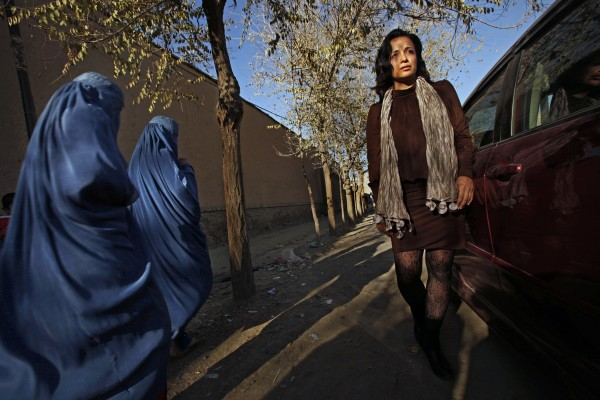 Women in burkas stare at Fereshta with her bare legs and uncovered head, in Old Kabul's Shar-e-Kohna neighborhood. Fereshta Kazemi visits the set of the drama series, &quotKocha-e-Ma&quot or &quotOur Street,&quot in which she will soon star.