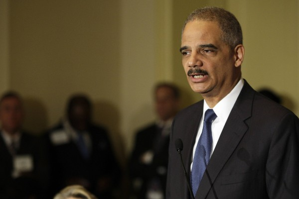 U.S. Attorney General Eric Holder speaks about gun violence to the U.S. Conference of Mayors winter meeting in Washington, on Friday, Jan. 18, 2013. Holder said on Friday that President Barack Obama acted within his legal authority when Obama unveiled a set of executive actions to try to reduce gun violence.