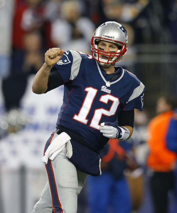 New England Patriots quarterback Tom Brady celebrates after the Patriots scored a touchdown on a run by Shane Vereen during the first quarter against the Houston Texans in their NFL AFC Divisional playoff football game in Foxborough, Mass., on Jan. 13, 2013.