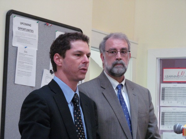 Maine Senate President Justin Alfond, D-Portland, stands alongside Biddeford Mayor and Democratic state Rep. Alan Casavant on Wednesday, Jan. 9, 2013, to describe the value of the $2.4 million in 21st Century program grants awarded recently by the Maine Department of Education.