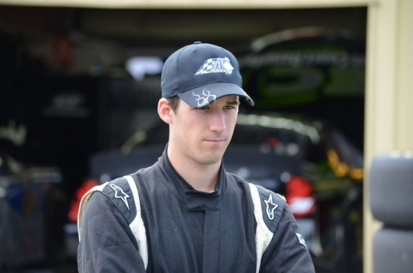 Austin Theriault looks over his car before pre-qualifying inspection for the NASCAR K&N Pro Series East race at New Hampshire Motor Speedway in Loudon, N.H., on Friday, Sept. 21, 2012. The Fort Kent native has recently relocated to North Carolina.