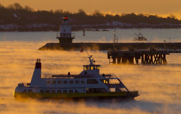 The ferry Machigonne II motors through sea smoke rising off the waters of Portland Harbor, passing Spring Point Light on its way in from the islands, on Thursday, Jan. 3 2013. The morning temperature was in the low single digits.