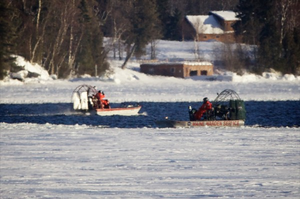 Air boats with the Maine Warden Service search Rangeley Lake on Thursday afternoon Jan. 3, 2012 for three missing snowmobilers.