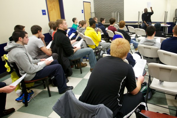 Former University of Maine tight end Daryl Fort, of Mentors in Violence Prevention, leads a frank discussion about date rape and appropriate sexual behavior with the University of Southern Maine men's track team in Gorham on Wednesday, Jan. 9, 2013.