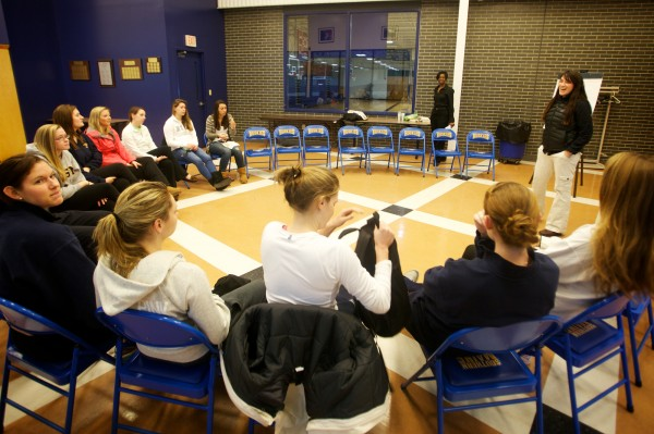 Amy Bowen of Mentors in Violence Prevention, herself a former three-sport college athlete, leads an open talk with the University of Southern Maine women's basketball team in Gorham on Wednesday, Jan. 9, 2013.