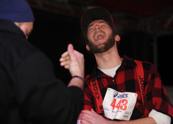 Dan Bullard howls as he is defeated by Nocturnem bouncer Jason Foley during the first annual Paul Bunyan arm wrestling contest in downtown Bangor during the New Year's Eve festivities Monday night. Foley defeated all three male Paul Bunyan contestants.