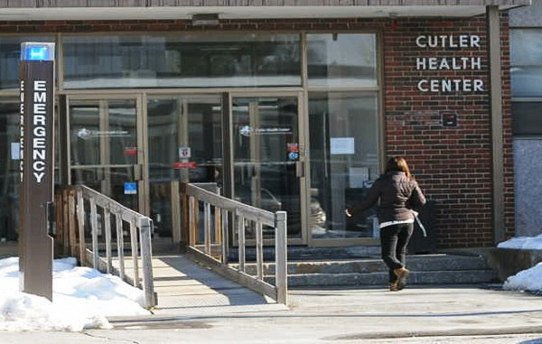 A woman enters the Cutler Health Center on the University of Maine campus in Orono on Friday, Jan. 11, 2013. UMaine officials say they are prepared for the flu if it should overtake the student body at Maine's flagship campus.