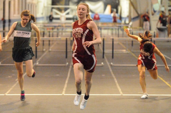 Bangor High's Grace MacLean takes first place in the girls 55-meter hurdles final during the PVC Eastern Maine Indoor Track League Championship in Orono last season. MacLean won the modern pentathlon and set a meet record in the 55  hurdles during the University of Southern Maine New Year's Relays.