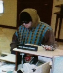 Police searching for man accused of robbing Portland credit union