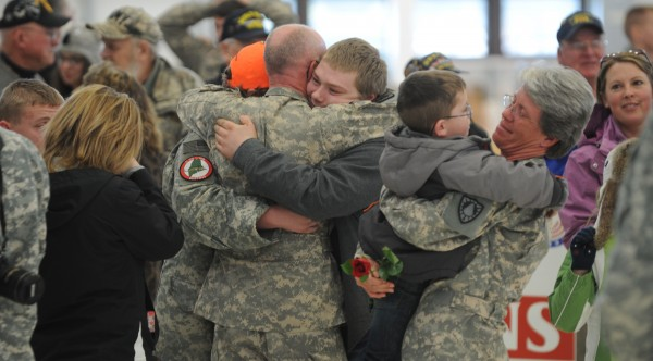 Family and friends embrace during a homecoming ceremony at the Army Aviation Support Facility on Hayes Street in Bangor on Friday, Jan. 25, 2013. The Maine Army National Guard