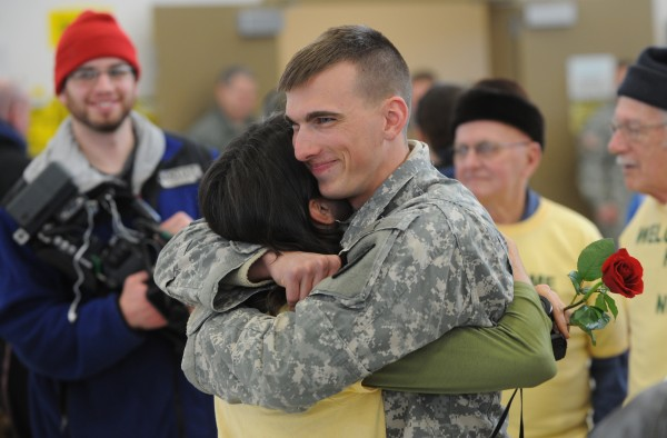 Nick Emery of Whitefield embraces his mother, Jeannine, during a homecoming ceremony at the Army Aviation Support Facility on Hayes Street in Bangor on Friday, Jan. 25, 2013. Emery has been deployed with the Maine Army National Guard