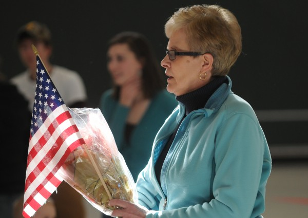Pat Lombard of Caribou waits with flowers for her daughter, Meaghan Falone, during a homecoming ceremony at the Army Aviation Support Facility on Hayes Street in Bangor on Friday, Jan. 25, 2013. Falone was returning from deployment with the Maine Army National Guard