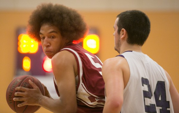 Bangor's Conner Adams (left) posts up against Hampden Academy's Tyler Norris (right) on Friday, Jan. 18, 2013.