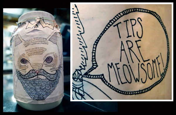 A cat says &quotTIPS ARE MEOWSOME!&quot on the tip jar at Joe's New York Pizza on Fore Street in Portland.