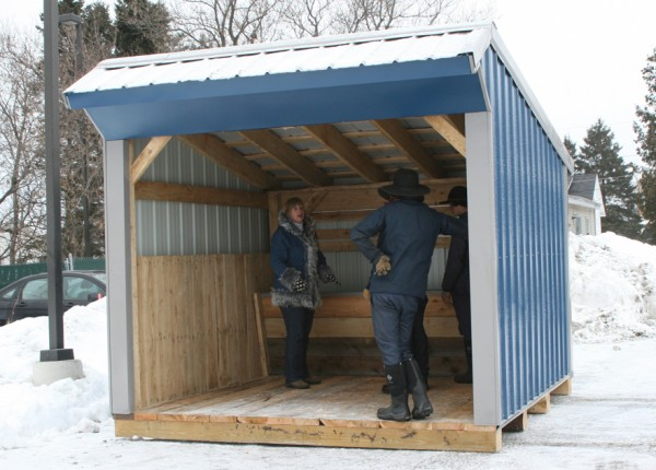 Catholic Charities Executive Director Dixie Shaw and Amish community members Abe Miller, Norman Miller and Dennis Gingerich seek shelter from a brisk Dec. 27, 2012. The building, built by the Amish community and set up at Catholic Charities in Presque Isle.