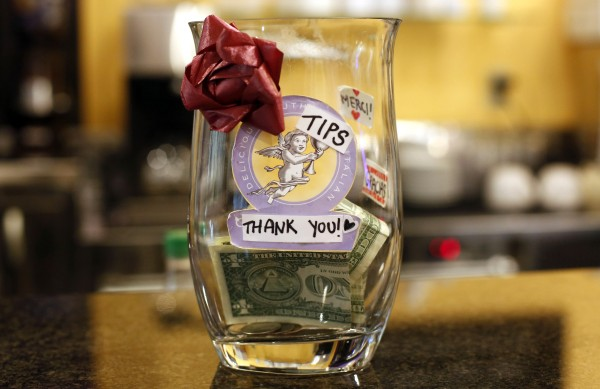 The tip jar at Gorgeous Gelato on Fore Street in Portland was bought at Goodwill. An employee accidentally broke its predecessor. Inside the jar are stickers that say 'thank you' in foreign languages.