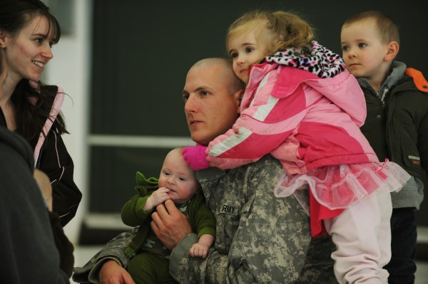 Jerrad Coffin of Naples (center) is surrounded by his family: son Tyson in his lap, daughter Ayana hanging on his shoulder, son Jeremiah behind him and wife Kim (left). Coffin was deployed with the Maine Army National Guard