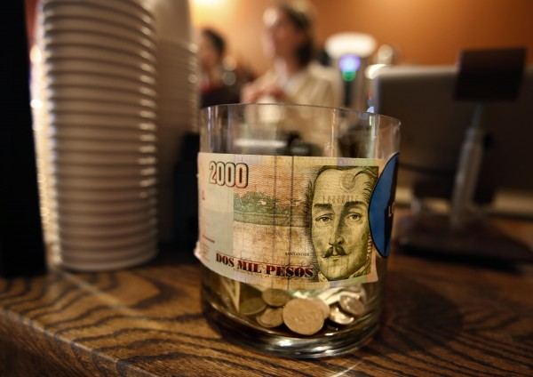 A 2000 peso Colombian bill featuring Gen. Francisco De Paula Santander graces the tip jar at the Speckled Ax Wood Roasted Espresso Bar on Congress Street in Portland. A customer left the bill as a tip. Its worth about $1.13.