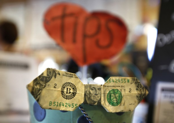A regular customer at Coffee By Design on Washington Street in Portland often folds his tips, prompting the barristers to tape one of them onto their tip jar.