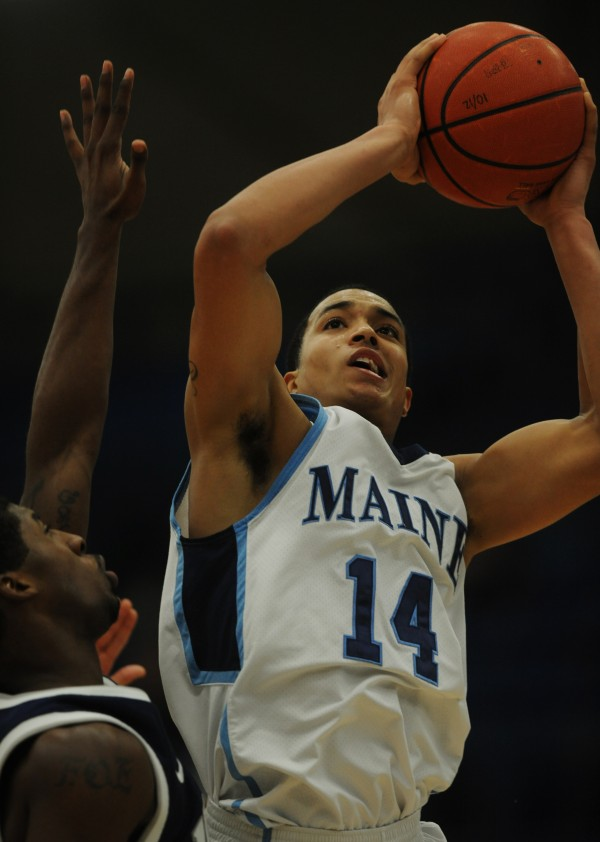 UMaine's Justin Edwards, shoots over New Hampshire defense Ferg Myrick during first half action at Orono on Wednesday, Jan. 30, 2013.