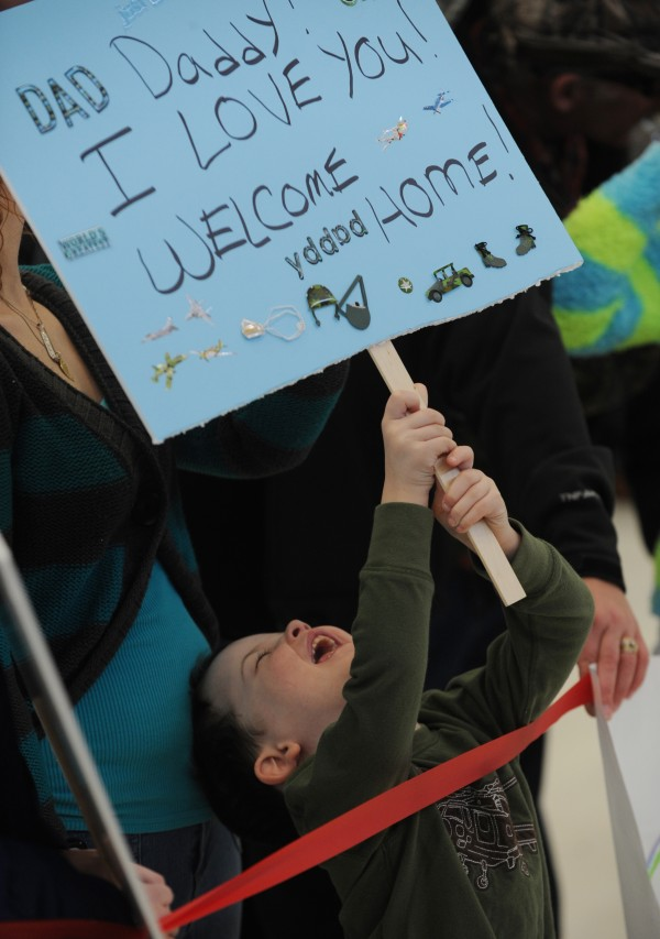 Tyler Dunham of Hudson waits for his father, Nicholas Dunham, who has been deployed with the Maine Army National Guard