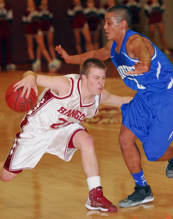 Bangor's Hunter Boyce tries to find a way around Lawrence's Xavier Lewis during second-quarter action at Bangor High School on Wednesday, Jan. 2, 2013. Lawrence won, 52-49.