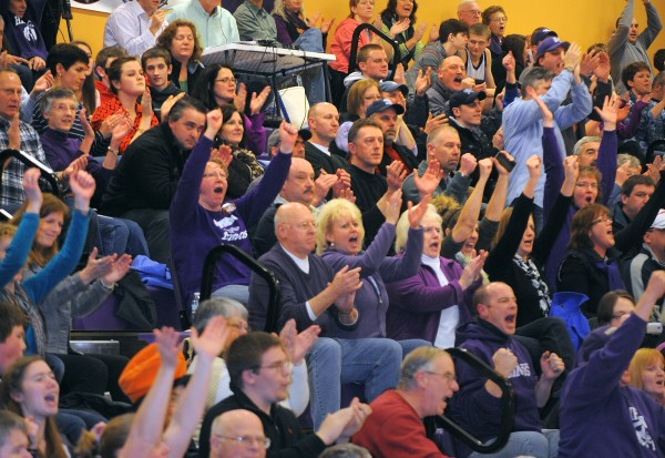 The fans react as Hampden Academy evens the score shortly before halftime during the game against Brunswick High School on Friday evening, Jan. 11, 2013.
