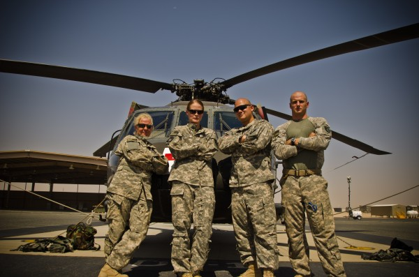 Maine Army National Guard Staff Sgt. Jessica Wing (left) stands with members of Bangor's 126th Aviation Medevac unit in the Middle East in this undated photo with a UH-60 Blackhawk in the background. Wing, 42, who was from Glenburn, Maine, and Alexandria, Va., was a crew chief and died on  Aug. 27, 2012, while serving in Kuwait.