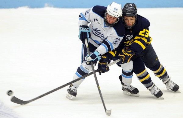 Merrimack's Josh Myers (left) gets the puck away from Maine's Adam Shemansky in the first period of Friday nights game at Alfornd Arena on Friday, Jan. 18, 2013.