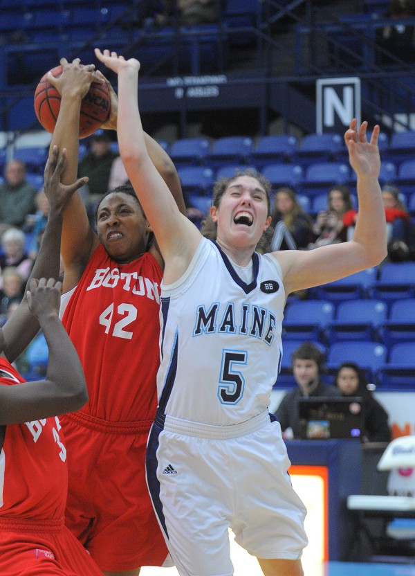 Boston University's Whitney Turner (left) takes a rebound over the University of Maine's Danielle Walczak during the first half of the game in Orono on Wednesday night.