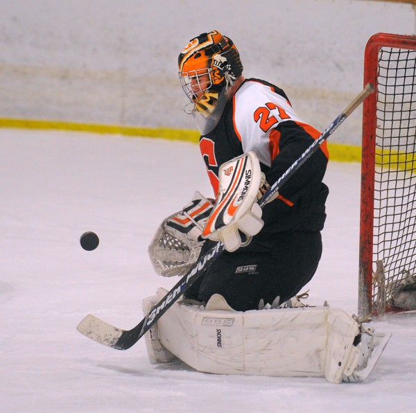 Skowhegan's goalie Sam Edmondson makes a save during the game against Hampden in Brewer on Wednesday, Jan. 9, 2013.