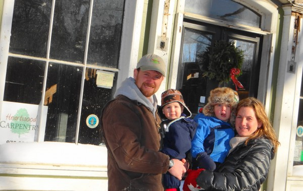 Jeremy and Marcie Howard and two of their three sons, Cael and Ewan, pose in front of the Lincolnville Center Store. The couple are renovating the store and plan to have it open in the spring.