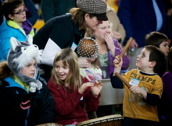 Children and adults join in a drum circle at the Ocean Avenue Elementary School's Martin Luther King Day event Monday, Jan 21, 2013.