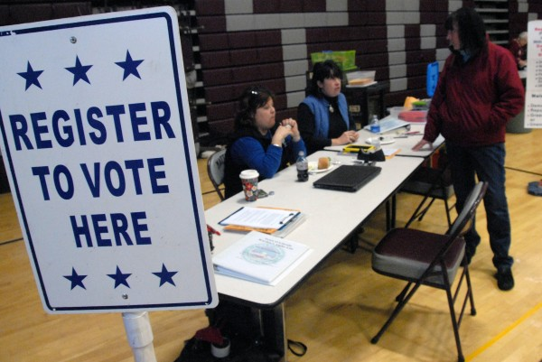 Lincoln Town Clerk Shelly Crosby (far left) chats with a voter during the RSU 67 referendum on Thursday, Jan. 10, 2013.
