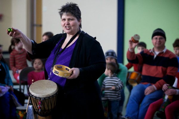 Patsy Onatah leads a drum circle at the Ocean Avenue Elementary School's Martin Luther King Day event Monday, Jan 21, 2013.