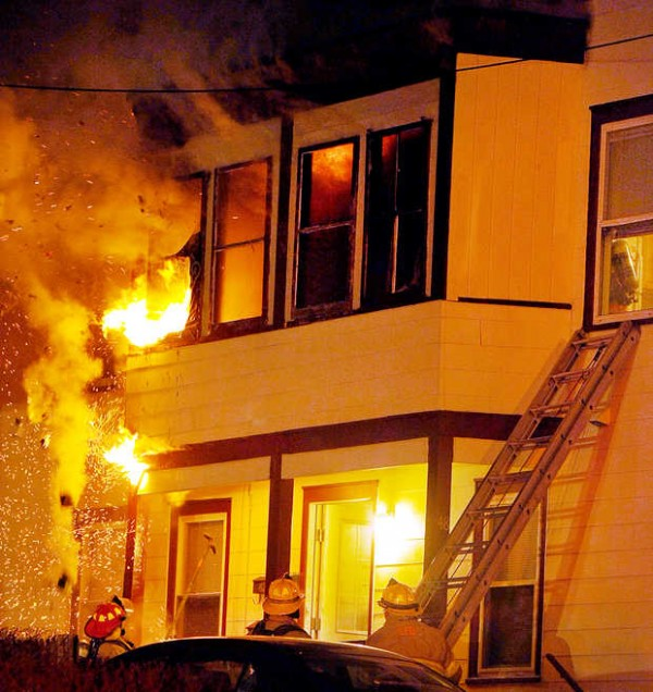 Firefighters battle a blaze at 48 Pleasant St. in Lewiston on Thursday night.