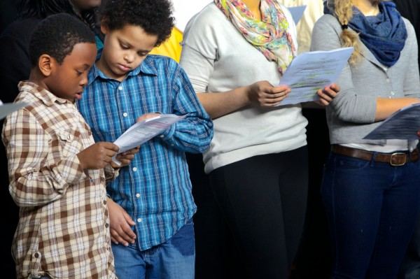Sam Anderson, 8, (left) and Thando Mngqibisa, 10, get ready to perform their part in a staged reading of the book &quotMartin's Big Words&quot at the Ocean Avenue Elementary School's Martin Luther King Day event Monday, Jan 21, 2013.