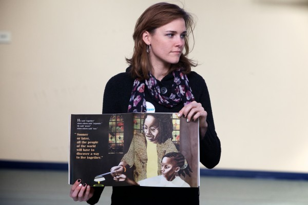 Volunteer Sara Everest holds the book &quotMartin's Big Words&quot during a staged reading at the Ocean Avenue Elementary School's Martin Luther King Day event Monday, Jan 21, 2013.
