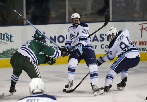 Maine's Connor Leen gets caught in the middle as his teammate Devin Shore (right) fights for the puck with Mercyhurst's Tyler Shipo in the second period at the Cumberland County Civic Center, Friday, Jan 4, 2013, in Portland, Maine.