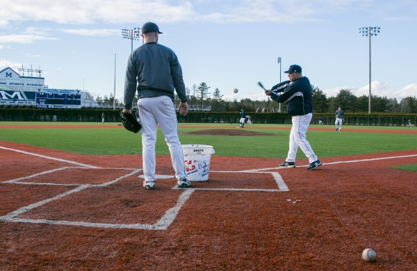 The University of Maine baseball team took advantage of the warmer weather and practiced outside on Thursday, Jan. 31, 2013. The team normally practices in the adjacent Mahaney Dome during the winter months.