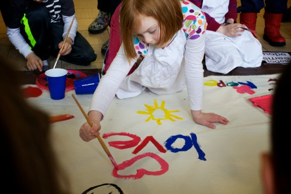 Fiona Johnson, 7, contributes to a mural, which will hang at Portland's city hall in February, at the Ocean Avenue Elementary School's Martin Luther King Day event Monday, Jan 21, 2013.