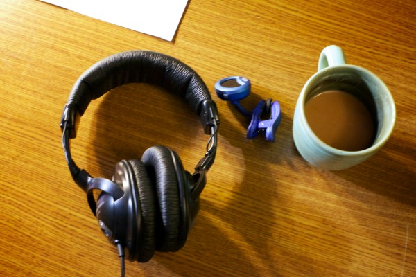 Headphones, a tuner and a mug of tea sit on the desk in singer-songwriter Jud Caswell's home recording studio Tuesday, Jan. 22, 2013.