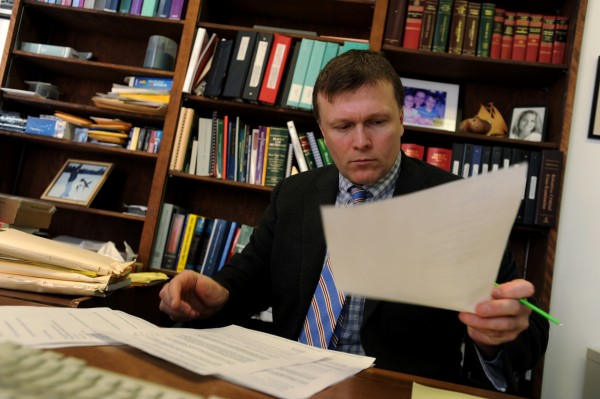 Bangor attorney Richard Hartley, president of the Maine Association of Criminal Defense Lawyers, sits at his desk during an interview on Friday in Bangor.