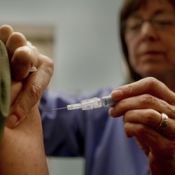 Pharmacies pick up slack in doling out flu shots