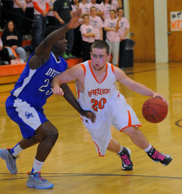 Brewer High School's Brendan Newcomb (right) drives on Lewiston High School's Donne Agossou during the first half of the game in Brewer on Friday, Jan. 25, 2013.