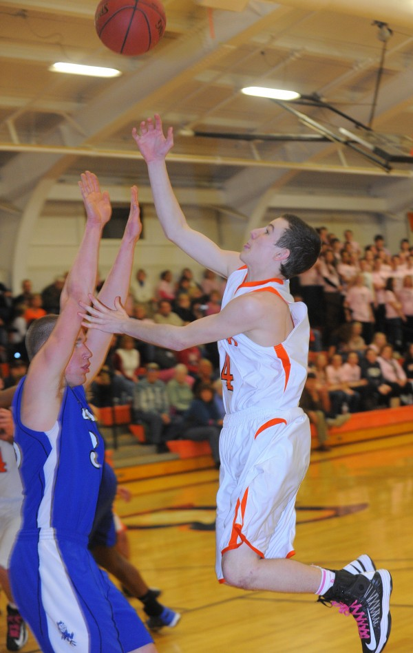 Brewer High School's Zachary Gulesian (right) goes for a layup over Lewiston High School's Steven Patrie during the first half of the game in Brewer on Friday, Jan. 25, 2013.