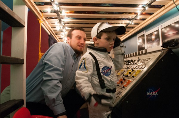 Jeremiah Gorman (left) starts a countdown with his 5-year-old son Finn on Thursday, Jan. 24, 2013. Gorman built the space command center for his son's birthday out of old, donated electronics.
