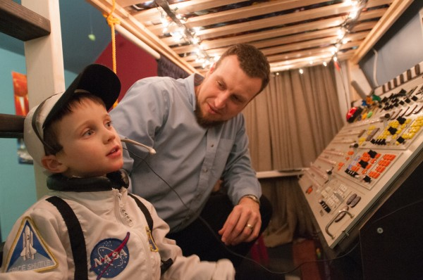 Jeremiah Gorman (right) starts a countdown with his 5-year-old son Finn on Thursday, Jan. 24, 2013. Gorman built the space command center for his son's birthday out of old, donated electronics.