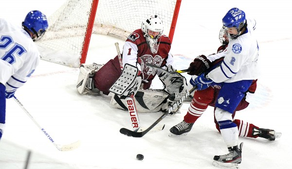 Lewiston's Matt Poulin (left) and Evan Gosselin (right) look to pounce on a rebound, but Bangor goalie Rye Powell swept it away with his stick during a game at the Androscoggin Bank Colisee in Lewiston on Monday, Jan. 21, 2013.